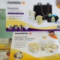 Medela freestyle spare part kit x2Medela Breastmilk storage solution x1Medela freestyle hands-free double electric breast pumpx1